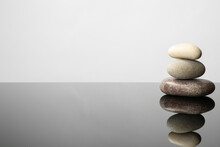 Stack Of Spa Stones On Mirror Surface. Space For Text
