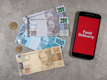 Delivery Food On Screen And Money Background. E-commerce And Online Order Infographic Concept. Online Delivery Service Concept, Online Order Tracking, Delivery.