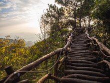 The Beautiful Mountain Path With Original Woods In Sunset Time.
