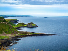 Northern Ireland, UK.  Giant's Causeway, Unique Natural Geological Formations Of Volcanic Basalt Rocks, Resembling Cobblestones Or Organ Pipes. Atlantic Coast With Bays And Peninsulas