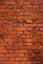 Old Red Brick Wall. The Texture Of Weathered Grungy Brickwork. Masonry Background.