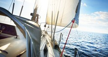 View Forward From A Sailboat Tilted By The Wind. Sea, Waves And Water Splashes. Clear Blue Sky. Transportation, Nautical Vessel, Cruise, Sport, Regatta, Recreation, Leisure Activity