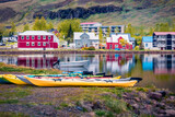 Landscape photography. Captivating morning cityscape of small fishing town - Seydisfjordur. Beautiful summer scene of east west Iceland, Europe. Traveling concept background.