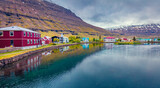 Beautiful Arctic scenery. Gloomy morning cityscape of small fishing town - Seydisfjordur. Adorable  summer scene of east west Iceland, Europe. Traveling concept background.
