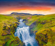 canvas print picture - Two cascade waterfall on Skoga river. Amazing summer view from the tourist trek from famous Skogafoss waterfall to the top of the river. Stunning sunrise in Iceland, Europe.