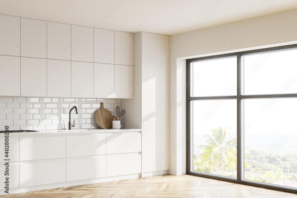Fototapeta White kitchen corner with cupboards