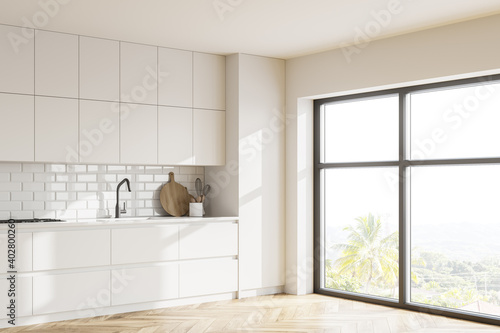 White kitchen corner with cupboards