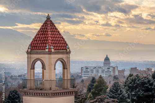 Bell tower against distant views of downtown and Utah State Capital Building