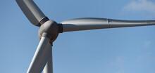 Detail Of Wind Turbine Against Blue Sky, Clean Energy Generator Wind Turbine In Wind Farm