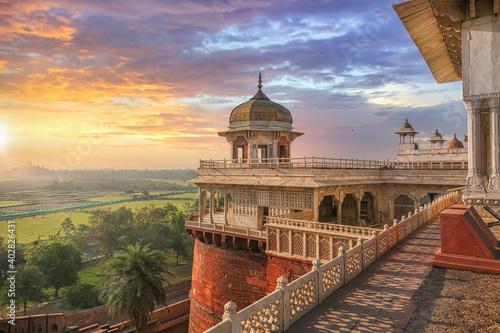 Fototapeta Agra Fort - Medieval Indian fort made of red sandstone and marble at sunrise Agr