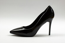 Black Patent Women's Shoes On A Gray Background. Women's Stiletto Heels