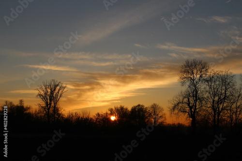 Fototapeta Słońcem malowane - piękny zachód słońca obraz