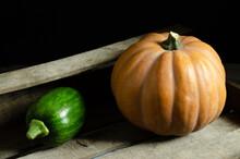 Pumpkin Lies On Planks On A Black Background