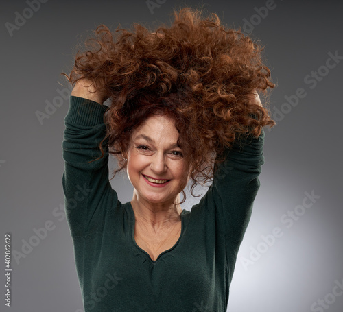 Senior woman on gray background