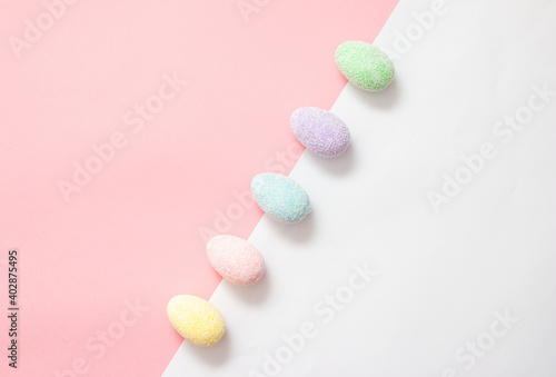 Colorful creative easter eggs on a pink and white background diagonally placed Poster Mural XXL