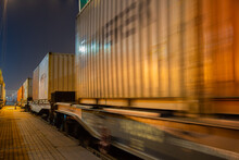Container Train Starts Moving By Rail At Night