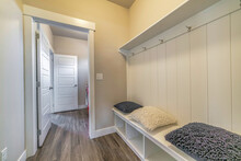 Mud Room Interior Of A House With Hooks Shelves And Built In Bench With Pillows