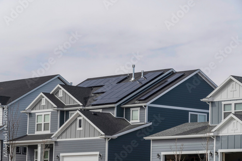 Fototapeta Home exterior with solar panels using sunlight as alternative electricity source