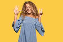 Beautiful Caucasian Teenager Girl Wearing Summer Dress Showing And Pointing Up With Fingers Number Seven While Smiling Confident And Happy.