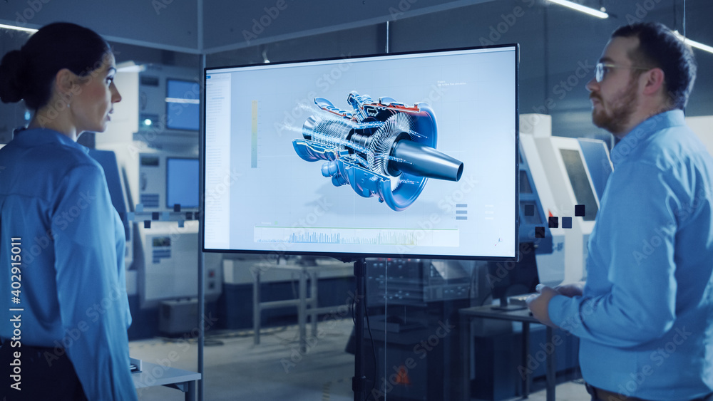 Fototapeta Office Meeting: Confident Female Engineer Talks to Project Manager, Watching Interactive Digital Whiteboard TV that Shows New Sustainable Eco-Friendly Engine 3D Concept. Modern Factory with Machinery