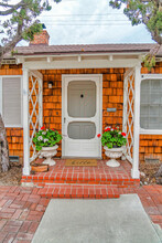 Beautiful Facade Of House With Steps Portico And Storm Door At The Entrance