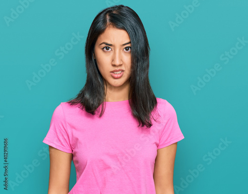 Obraz na plátně Beautiful asian young woman wearing casual pink t shirt skeptic and nervous, frowning upset because of problem