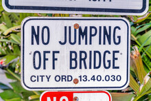 Close Up View Of No Jumping Off Bridge Sign In Huntington Beach California