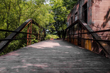 Bridge Over The River With Abandoned Building