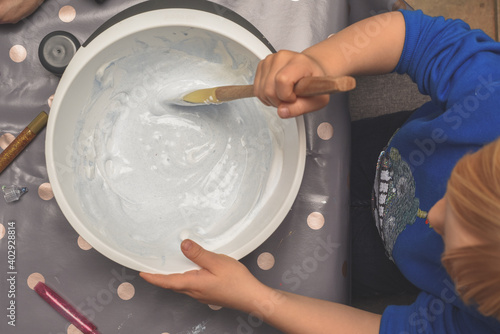 Photo Kids activity of making slime as a science experiment for children to do indoors