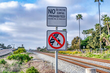 No Walking On Railway Sign And No Trespassing And Dumping Sign In San Diego CA