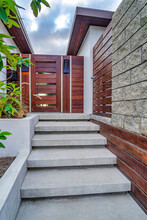 Stairs Against Wooden Gate And Door At House Entrance In San Diego California