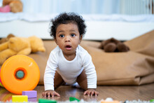 Happy African American Little Baby Boy Crawling And Looking For Some Thing To Learn