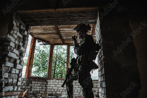 Fotografie, Obraz Military man standing inside the building and waiting for command