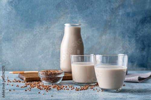 Obraz Glasses of buckwheat milk on table - fototapety do salonu