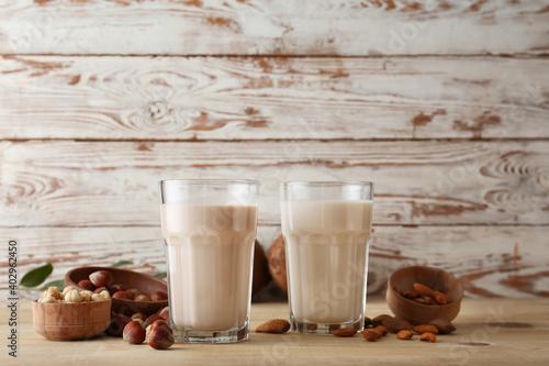 Obraz Glasses of tasty vegan milk on table - fototapety do salonu