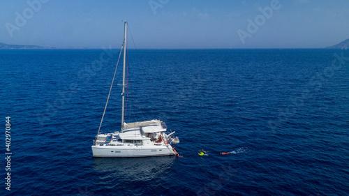 Fotografering Catamaran sailing in blue, turquoise water in Greece, beautiful catamaran during