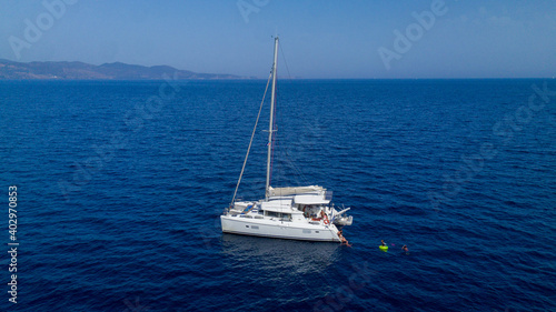 Canvastavla Catamaran sailing in blue, turquoise water in Greece, beautiful catamaran during