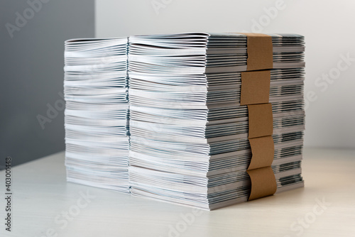 Fototapeta Bundles of newly printed catalogues in a stack obraz