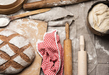 Bread, Kneaded Dough Of White Wheat Flour Lies On A Metal Bucket And A Wooden Rolling Pin