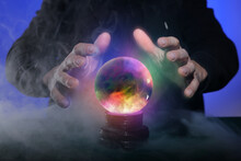 Fortune Teller With Crystal Ball On Color Background, Closeup