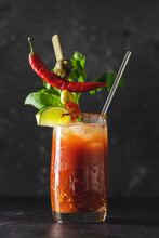 Glass Of Vodka And Tomato Juice Drink With Celery, Spices, Salt And Ice In Portion Glasses. Bloody Mary Cocktail With Many Garnishes