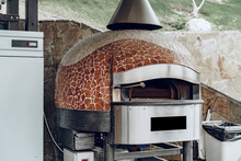 Outdoor Pizza Oven With Mosaic Decoratiion In A Restaurant