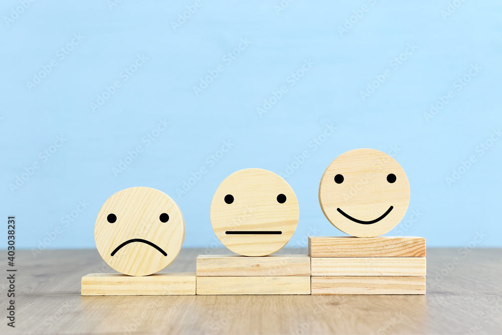 Fototapeta Concept image of satisfaction level. wooden circles with emotions