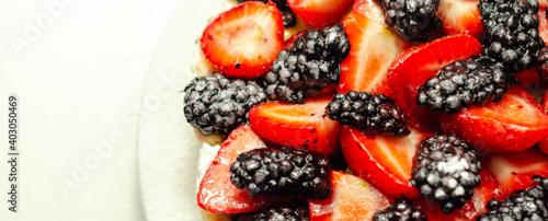 Fototapeta Butter enriched shortcrust pastry topped strawberries and blackberries, seasonal