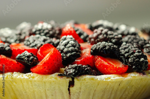 Fotografie, Obraz Butter enriched shortcrust pastry topped strawberries and blackberries, seasonal