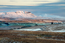Pen-y-ghent Covered In Snow With Beautiful Winter Evening Sunlight. Yorkshire Dales National Park, UK.