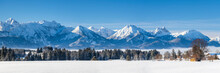 Beautiful Panoramic Landscape Wirh Mountain Range In Bavaria, Germany, At Cold Winter Day