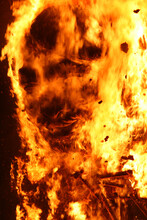 Burning Sculpture Made With Paper Mache With Human Face Look Alike In Burning Process