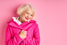 Elderly Woman Posing In Pink Stylish Coat, Charming Caucasian Female Is Smiling. Style, Fashion Concept