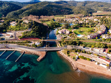 Aerial View Of Small River Flowing Inside Mediterranean Sea Cote D'Azur Turquoise Waters Under A Train Bridge And Road Bridge In French Riviera